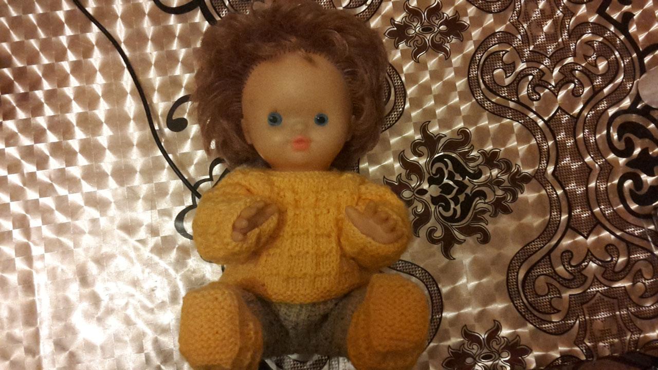 кукла в вязанном