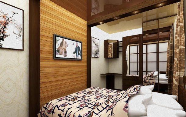 постель в спальне с телевизором и картиной